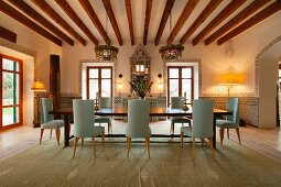 Dining room with wooden ceiling beams