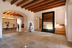 Tile floor and wooden ceiling beams in entry of Spanish villa
