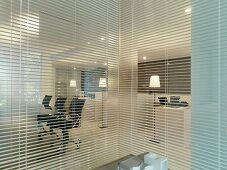 Blinds separating offices in modern office