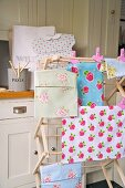 Floral fabrics hanging on clothes horse