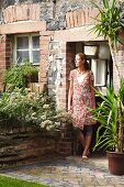 Woman in front door of old country house