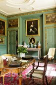 Baroque writing room with upholstered furniture and gilt-framed oil paintings on green walls