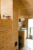 Black stove between chimney breast and partition