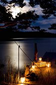 Romantic atmosphere on candlelit jetty under dramatic sky