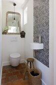 White designer bathroom fixtures in a Mediterranean bathroom