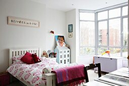 Light and bright teenage bedroom with a glass bay window
