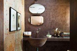 Masonry washstand with shelf and oval mirror in rustic, minimalist bathroom