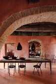 View into a brick red dining room