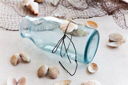 Jar with cord and seashells