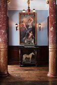 View between two marble columns of horse statue under console table below painting in style of old masters