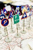 Vintage toys - miniature traffic signs standing on map