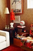 Table lamp on side table flanked by upholstered armchairs in corner of living room