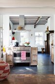 Open-plan kitchen in renovated country house