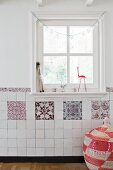 Traditional hand-made tiles below lattice window