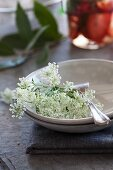 Cow parsley and silver fork in a dish