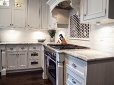 Kitchen with Marble Counter Tops and an Oven