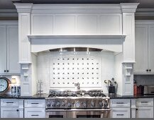 Kitchen with White Cabinets and a Stainless Steel Oven