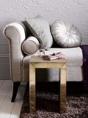 Chaise longue with cushions and side table