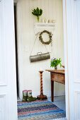 Antique candlestick and table in hall
