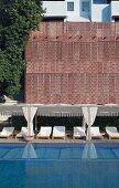 Luxurious swimming pool and loungers in Raas Haveli Hotel, Jodhpur, India