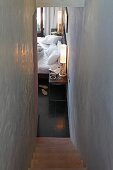 Narrow staircase with view into guest room in Raas Haveli Hotel, Jodhpur, India
