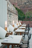 Set, outdoor tables in restaurant of Raas Haveli Hotel, Jodhpur, India