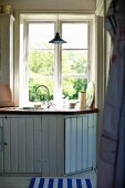 Kitchen counter below window with fitted wooden base units