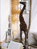 Wooden giraffe and lantern ornaments