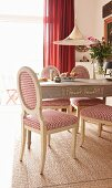 Country-house chairs with red and white houndstooth upholstery on herringbone rug