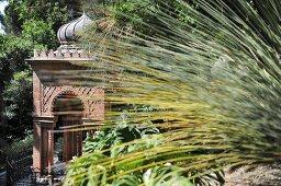 Moorish-style pagoda in sunny, Mediterranean garden