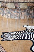 Zebra skin rug on glossy stone floor in front of bar counter