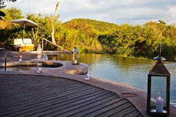 Complete peace and relaxation next to luxurious infinity pool in green landscape