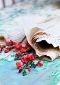 Sprays of red bean flowers wrapped in newspaper