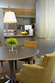 Round dining table with Retro chairs