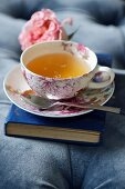 Tea, in a teacup with a floral pattern
