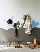 Cloakroom area with mural, coat pegs & shoe rack