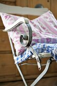 Cushions made from vintage fabrics on old garden chair