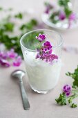 Coconut drink with scented geranium oil & pelargonium flowers