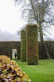 Park-like gardens with clipped hedges & cylindrical shrubs