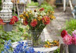 Summer bouquet of dahlias, alstroemeria and rudbeckia on garden table