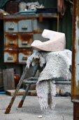 Sculptural object on vintage stool in workshop