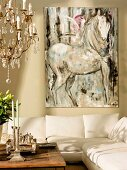 Modern painting of horse above cream sofa; chandelier with crystal ornaments on left in foreground