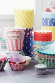 Stacked paper cake cases and cupcake cases
