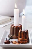 Copper jelly moulds used as candlesticks