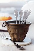 Small jelly mould used as cutlery caddy for buffet