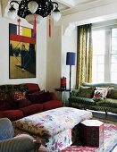Combination of various sofas, floral ottoman box, Chinese ceiling lamp and modern art in living room