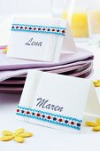 Hand-crafted name cards with ribbon trim