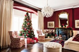 Grand living room with bay window and Christmas tree decorated in red and white