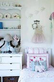 Corner of girl's bedroom in romantic decor