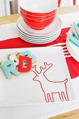 Letter-shaped biscuits on white plate with reindeer motif